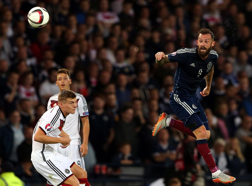Scotland's Steven Fletcher, right, vies for the ball with Germany's Toni Kroos, left, during their Euro 2016 Group D qualifying soccer match at Hampden Park, Glasgow, Scotland, Monday Sept. 7, 2015. (AP Photo/Scott Heppell)
