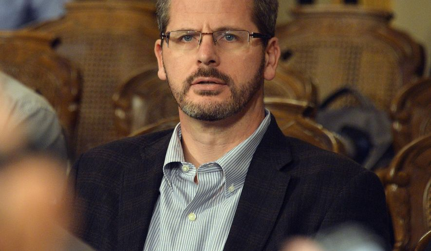 State Rep. Todd Courser, R-Lapeer, listens during a legislative hearing Tuesday, Sept 8, 2015, in Lansing, Mich.  The top lawyer for the Michigan House recommended Tuesday, Courser be expelled and Rep. Cindy Gamrat, R-Plainwell, censured for misconduct stemming from an attempt to hide their extramarital affair.   (Dale G. Young/Detroit News via AP)  DETROIT FREE PRESS OUT; HUFFINGTON POST OUT; MANDATORY CREDIT
