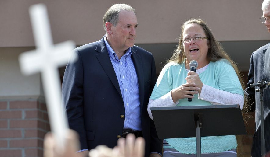 Rowan County Clerk Kim Davis, with Republican presidential candidate Mike Huckabee, left, at her side, speaks after being released from the Carter County Detention Center, Tuesday, Sept. 8, 2015, in Grayson, Ky. Davis, the Kentucky county clerk who was jailed for refusing to issue marriage licenses to gay couples, was released Tuesday after five days behind bars.   (AP Photo/Timothy D. Easley)