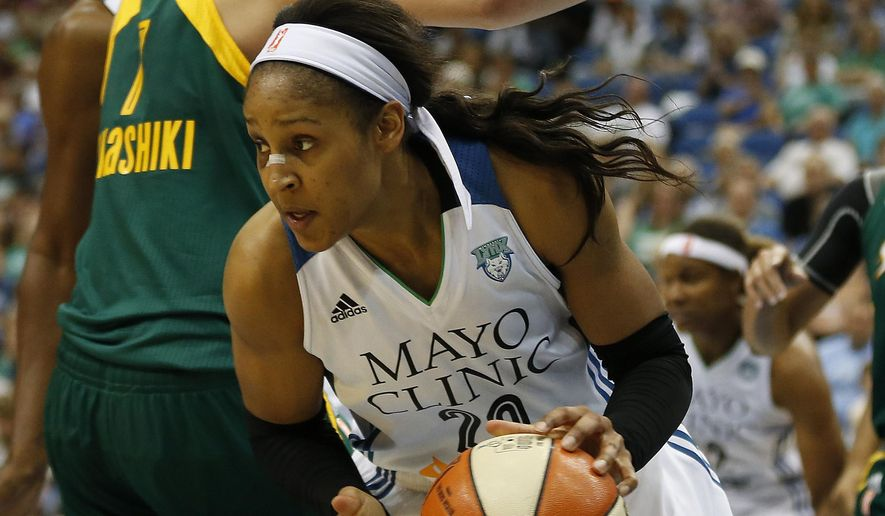 Minnesota Lynx forward Maya Moore (23) drives the ball around Seattle Storm forward Ramu Tokashiki (7) during the first half of a WNBA basketball game, Tuesday, Sept. 8, 2015, in Minneapolis. (AP Photo/Stacy Bengs)