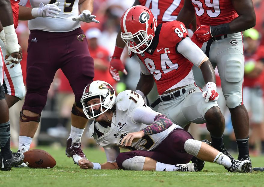 Louisiana Monroe quarterback Garrett Smith gets up after being tackled by Georgia linebacker Leonard Floyd during an NCAA college football game in Athens, Ga., Saturday, Sept. 5, 2015. (Brant Sanderlin/Atlanta Journal-Constitution via AP)  MARIETTA DAILY OUT; GWINNETT DAILY POST OUT; LOCAL TELEVISION OUT; WXIA-TV OUT; WGCL-TV OUT; MANDATORY CREDIT