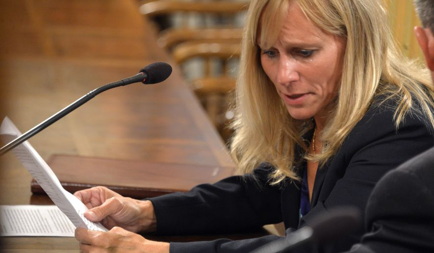 State Rep. Cindy Gamrat, R-Plainwell, tears-up as she reads one of two apologies at a legislative hearing in the House Appropriations committee room, Tuesday, Sept 8, 2015, in Lansing, Mich.  The top lawyer for the Michigan House recommended Tuesday, that Rep. Todd Courser be expelled and Gamrat censured for misconduct stemming from an attempt to hide their extramarital affair.   (Dale G. Young/Detroit News via AP)  DETROIT FREE PRESS OUT; HUFFINGTON POST OUT; MANDATORY CREDIT