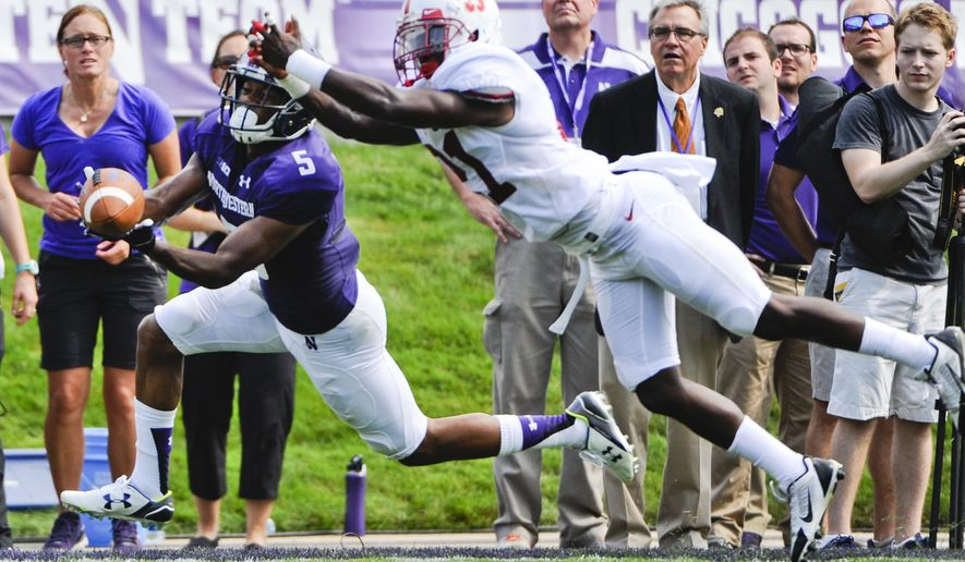 Northwestern wide receiver Miles Shuler (5) misses a pass while being defended by Stanford cornerback Ronnie Harris (21) in the second half of an an NCAA college football game in Evanston, Ill.,  Saturday, Sept. 5, 2015. (AP Photo/Matt Marton
