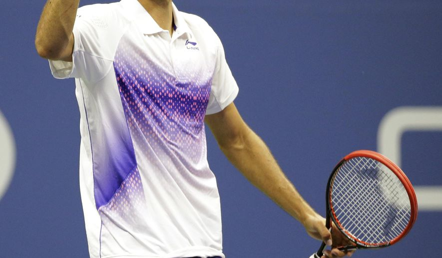 Marin Cilic, of Croatia, reacts after winning a point from Jo-Wilfried Tsonga, of France, during a quarterfinal match at the U.S. Open tennis tournament, Tuesday, Sept. 8, 2015, in New York. (AP Photo/David Goldman)