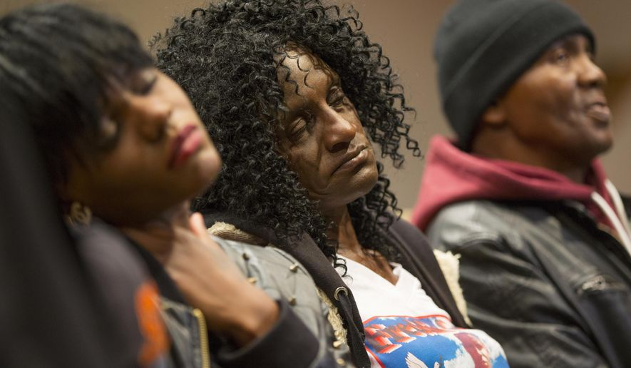 FILE - In this April 27, 2015, file photo, family members of Freddie Gray, sister Fredricka Gray, left, mother Gloria Darden, center, and stepfather Richard Shipley listen during a news conference after a day of unrest following the funeral of Freddie Gray in Baltimore. Gray's parents reached a tentative $6.4 million settlement with the city of Baltimore. The deal, announced Tuesday, Sept. 8, 2015, appeared to be among the largest settlements in police death cases in recent years and happened just days before a judge is set to decide whether to move a trial for six officers charged in Gray's death. (AP Photo/Evan Vucci, File)