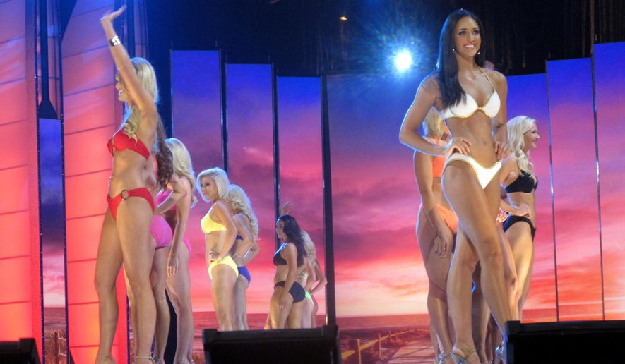 Contestants compete in the swimsuit portion of the 2016 Miss America pageant during the first night of preliminary competition, Tuesday Sept. 8, 2015, at Boardwalk Hall in Atlantic City, N.J. The new Miss America will be crowned in Sunday night's nationally televised finale. (AP Photo/Wayne Parry)