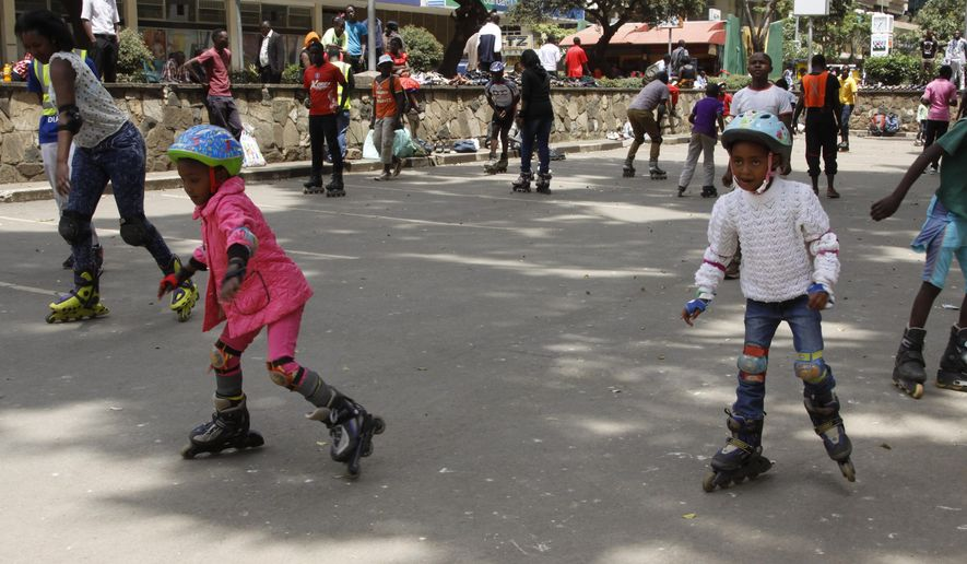 In this photo taken on Sunday, Sept. 6, 2015, young children practice skating in downtown Nairobi , Kenya. A craze for roller skating has hit Kenya, fueled by its growing middle class and a love for speed. Lameck Wafula is the secretary-general of the Kenyan Federation of Roller Skating, which was created in 1997 with four members and now oversees 60 skating clubs. More than 100 schools feature roller skating at gym. A speed-skating tournament in June drew more than 400 participants from all over Kenya with hundreds more watching. A music video by Kenyan hip hop artist Octopizzo features skating. Even the police department sponsors a skating team.  (AP Photo/Jay Lawrence)