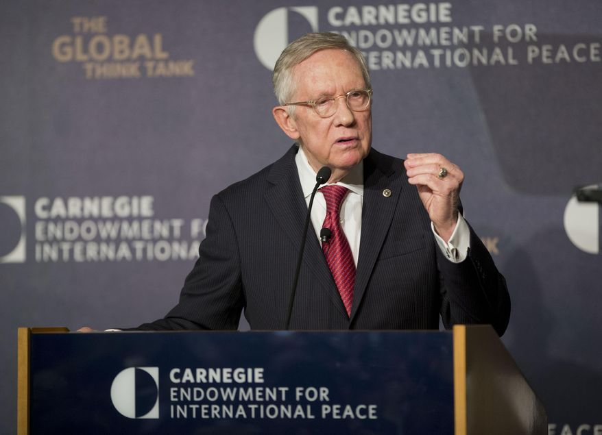 Senate Minority Leader Harry Reid, Nevada Democrat, discusses the Iran nuclear agreement during his speech at the Carnegie Endowment for International Peace in Washington on Sept. 8, 2015. Lawmakers returning to Washington from their summer recess are plunging immediately into bitter, partisan debate over the Iran nuclear accord. The deal struck by Iran, the U.S. and five world powers in July is aimed at curbing Iran's nuclear program in exchange for hundreds of billions of dollars in relief for economic sanctions. (Associated Press)