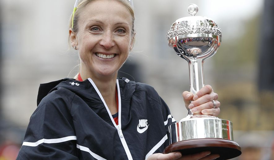 "FILE- In this file photo dated Sunday, April 26, 2015, British athlete Paula Radcliffe after she was presented with a lifetime achievement award during the 35th London Marathon.  The three-time London Marathon winner and World record holder, Radcliffe has denied doping at any time, saying, ""I categorically deny that I ever resorted to cheating in any form whatsoever at any time in my career."" after she was ""effectively"" implicated during a Parliamentary hearing into allegations of widespread blood doping recently published in a British national newspaper. (AP Photo/Kirsty Wigglesworth, FILE)"