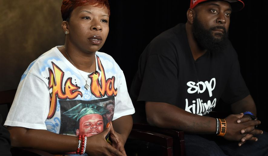 FILE - In this Sept. 27, 2014 file photo, Michael Brown Sr. and Lesley McSpadden, the parents of Michael Brown, speak to The Associated Press during an interview in Washington. A federal judge has scheduled an October 2016 trial in the case of Brown Sr. and McSpadden against the city of Ferguson, Mo., its former police chief and the white ex-officer, Darren Wilson, who killed the 18-year-old Brown, online court records show Sept. 8, 2015.  (AP Photo/Susan Walsh, File)