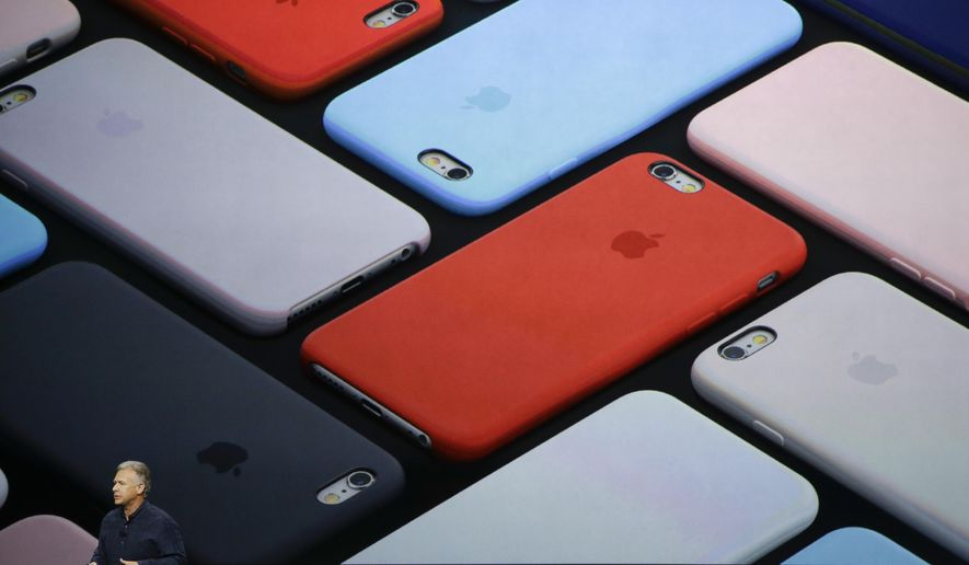 Phil Schiller, Apple's senior vice president of worldwide marketing, talks about the camera features of the new iPhone 6s and iPhone 6s Plus during the Apple event at the Bill Graham Civic Auditorium in San Francisco, Wednesday, Sept. 9, 2015. (AP Photo/Eric Risberg)