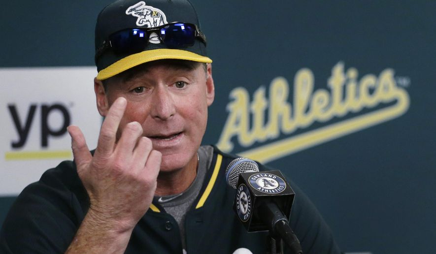 Oakland Athletics manager Bob Melvin, gestures during a media conference Wednesday, Sept. 9, 2015, in Oakland, Calif. Melvin has received a two-year contract extension that takes him through the 2018 season. General manager Billy Beane made the announcement Wednesday with the A's sitting as the worst team in the American League this year following three straight playoff seasons. (AP Photo/Ben Margot)
