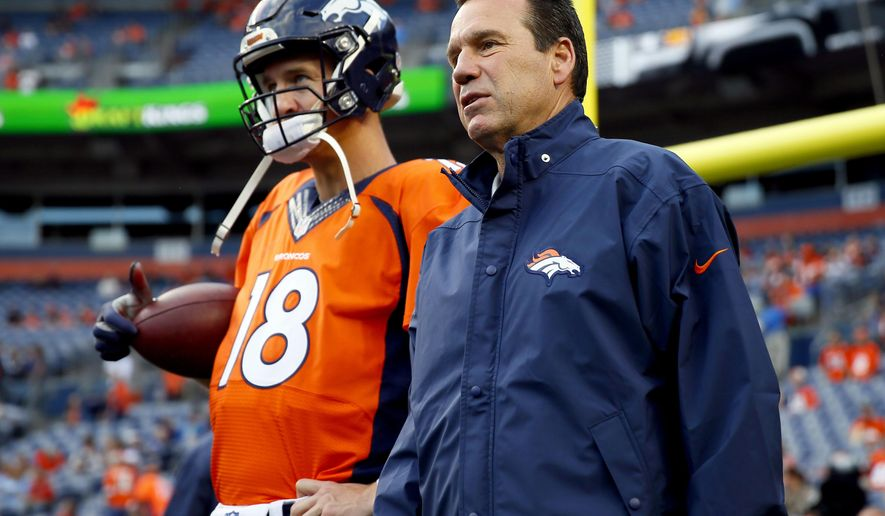 FILE - In this Sept. 3, 2015, file photo, Denver Broncos quarterback Peyton Manning (18) talks with head coach Gary Kubiak prior to an NFL preseason football game against the Arizona Cardinals in Denver. The Ravens enjoyed having Gary Kubiak on their side for one very productive season. There will be an awkward reunion Sunday when Baltimore opens the season against Kubiak's Denver Broncos. (AP Photo/Jack Dempsey, File)