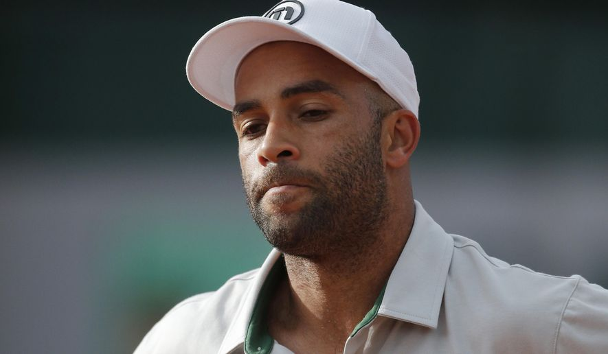 FILE - In this May 26, 2013, file photo, James Blake grimaces after missing a return against Serbia's Viktor Troicki at the French Open tennis tournament in Paris. Internal affairs detectives are investigating claims by former tennis professional James Blake that he was thrown to the ground and then handcuffed while mistakenly being arrested Wednesday, Sept. 9, 2015, at a New York hotel, police said. Blake, who's biracial, told the Daily News he wasn't sure if he was arrested because of his race but said the officer who put him in handcuffs inappropriately used force. (AP Photo/Michel Spingler, File)