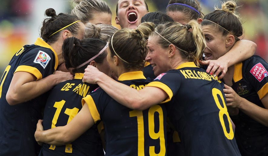 FILE - In this June 21, 2015, file photo, Australia players celebrate after Kyah Simon scored against Brazil during the second half of a FIFA Women's World Cup soccer match in Moncton, New Brunswick, Canada. Australia's two-match series in the United States to face the Women's World Cup champions has been called off as negotiations continue over a new collective bargaining agreement, the player's union said Wednesday, Sept. 9, 2015(Andrew Vaughan/The Canadian Press via AP, File) MANDATORY CREDIT
