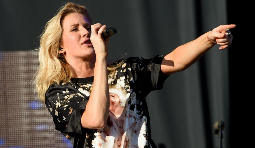 FILE - In this Sunday, Aug. 23, 2015 file photo, British singer Ellie Goulding performs on stage during V Festival 2015 at Hylands Park in Chelmsford, Essex, England. Goulding says her performance with the rock band Train at a concert in San Francisco to kick off the NFL season on Thursday, Sept. 10, 2015, is an opportunity for her to learn more about the American football. (Photo by Jonathan Short/Invision/AP, File)