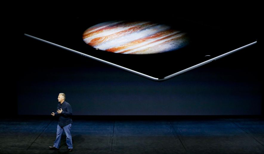 Phil Schiller, Apple's senior vice president of worldwide marketing, discusses the new iPad Pro during the Apple event at the Bill Graham Civic Auditorium in San Francisco, Wednesday, Sept. 9, 2015. (AP Photo/Eric Risberg)