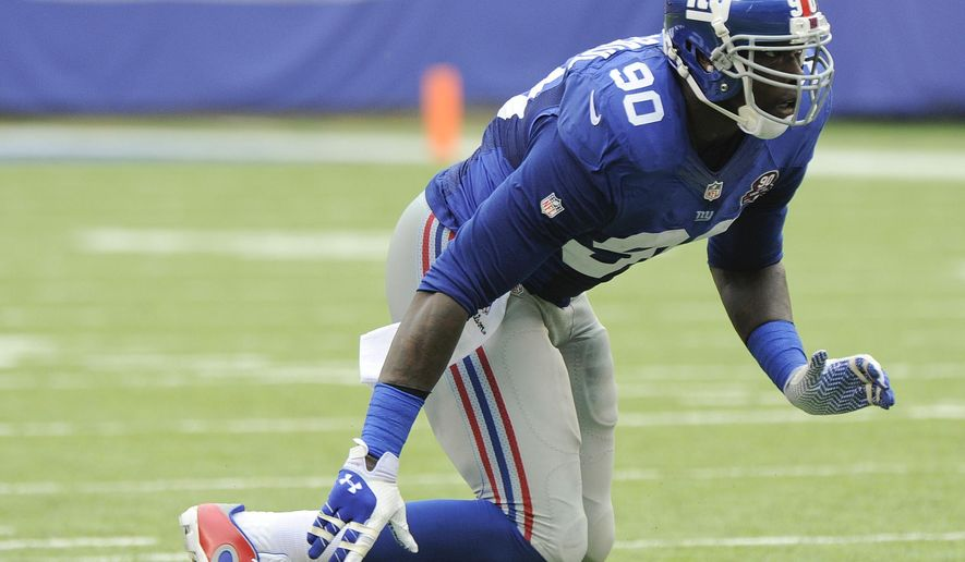 FILE - In this Sept. 21, 2014, file photo, New York Giants defensive end Jason Pierre-Paul (90) comes up off the line of scrimmage against the Houston Texans during an NFL football game in East Rutherford, N.J. Two-time Pro Bowl defensive end Jason Pierre-Paul is not ready to play for the Giants. Coach Tom Coughlin announced the decision Wednesday, Sept. 9, 2015, after the team examined the right hand that Pierre-Paul injured in a fireworks accident on the July Fourth holiday.(AP Photo/Bill Kostroun, File)