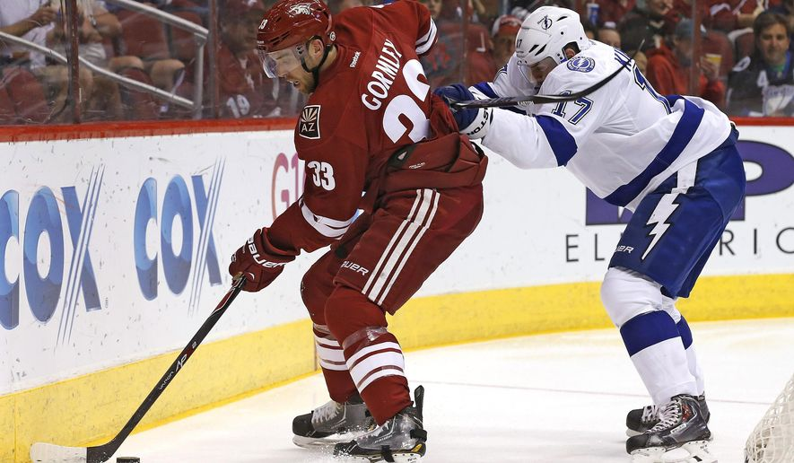FILE - In this Feb. 21, 2015, file photo, Arizona Coyotes' Brandon Gormley (33) tries to keep the puck away from Tampa Bay Lightning's Alex Killorn (17) during an NHL hockey game in Glendale, Ariz. The Coyotes traded defenseman Gormley to the Colorado Avalanche on Wednesday, Sept. 9, 2015, for defenseman Stefan Elliott. (AP Photo/Ross D. Franklin, File)
