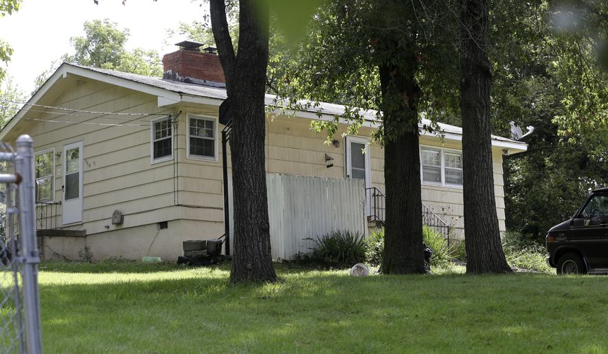This home in southeast Kansas City was a crime scene where three people, including an infant, were found fatally shot in Kansas City, Mo., Wednesday, Sept. 9, 2015. Capt. Tye Grant says a family member returned home and discovered the bodies of a man, woman and infant the night before.   (AP Photo/Orlin Wagner)