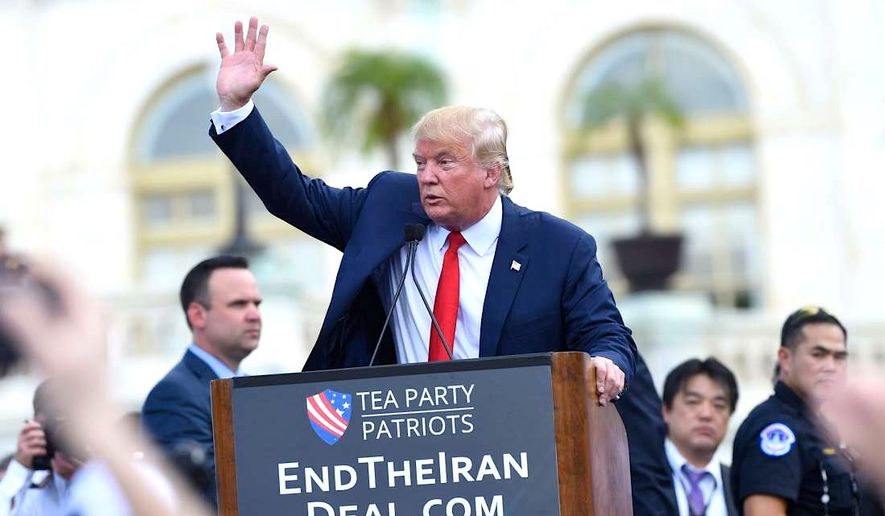 Republican presidential candidate Donald Trump waves to the crowd after speaking during a rally opposing the Iran nuclear deal outside the Capitol in Washington, Wednesday, Sept. 9, 2015. (AP Photo/Susan Walsh)