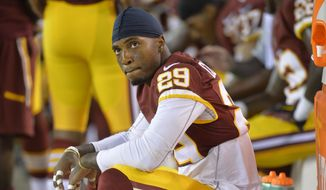 Washington Redskins defensive back Chris Culliver sits on the sideline during an NFL preseason football game against the Cleveland Browns Thursday, Aug. 13, 2015, in Cleveland. Washington won 20-17. (AP Photo/David Richard)