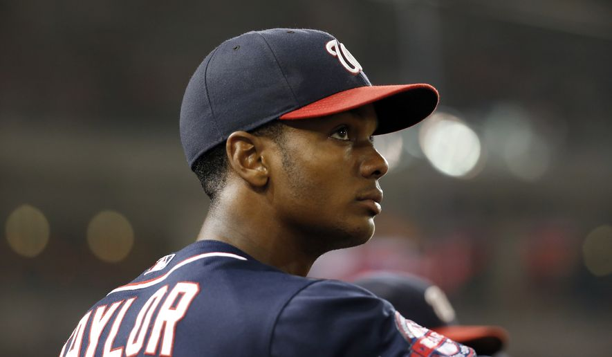 Washington Nationals center fielder Michael Taylor (3) stands on the edge of the dugout during a baseball game against the Atlanta Braves at Nationals Park, Friday, Sept. 4, 2015, in Washington. The Nationals won 5-2. (AP Photo/Alex Brandon)
