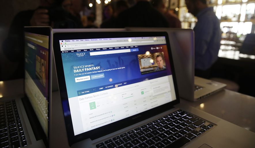 A laptop screen displays the new Yahoo Sports Daily Fantasy contest during a product launch Wednesday, July 8, 2015, in San Francisco. Yahoo designed the experience for the mobile fantasy player and offers Daily Fantasy, Full Season Fantasy, and real-time sports news and scores as an all-in-one experience. (AP Photo/Eric Risberg)