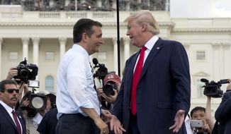 Republican presidential candidates Donald Trump and Sen. Ted Cruz of Texas greet each other on stage during a Sept. 9, 2015, rally on Capitol Hill in Washington organized by Tea Party Patriots to oppose the Iran nuclear agreement. (Associated Press) **FILE**