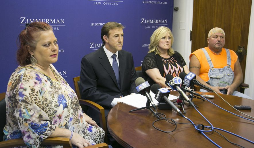 From left, Susan Rick, attorney Thomas Zimmerman, Rhonda Rasche and her boyfriend Dave Cox, talk to the media about their class-action lawsuit against the Illinois Lottery during a news conference Wednesday, Sept. 9, 2015 in Chicago. The individuals are suing the Illinois lottery for its failure to pay prizes more than $25,000 during the state's budget impasse. (Ashlee Rezin/ Sun-Times Media via AP) MANDATORY CREDIT, MAGS OUT, NO SALES, CHICAGO TRIBUNE OUT