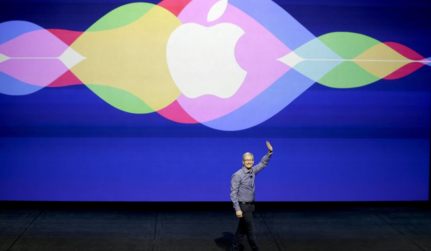 Apple CEO Tim Cook opens the Apple event at the Bill Graham Civic Auditorium in San Francisco, Wednesday, Sept. 9, 2015. (AP Photo/Eric Risberg)