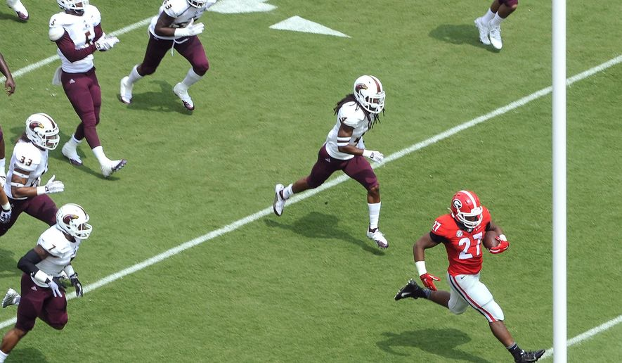Georgia running back Nick Chubb (27) scores a touchdown as Louisiana Monroe safety Tre' Hunter (4) and other defenders pursue during the first quarter of an NCAA college football game, Saturday, Sept., 5, 2015, in Athens, Ga. (AP Photo/John Amis)