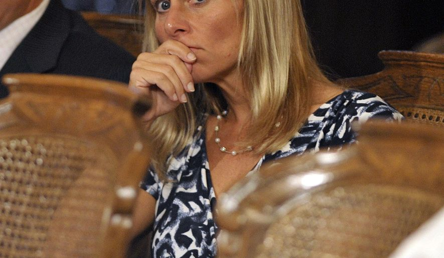 State Rep. Cindy Gamrat, R-Plainwell, listens closely as Rep. Todd Courser, R-Lapeer, testifies before a House committee, Wednesday, Sept 9, 2015, in Lansing, Mich. Courser, who tried to cover up his extramarital affair with Gamrat, says he's sorry and a censure would give him a chance to restore his dignity and rebuild the public's trust. (Dale G. Young/Detroit News via AP)  DETROIT FREE PRESS OUT; HUFFINGTON POST OUT; MANDATORY CREDIT