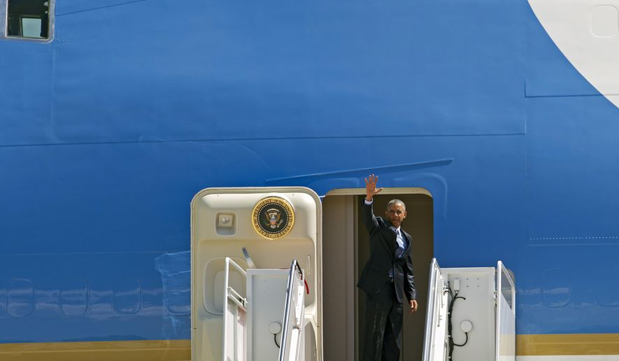 President Barack Obama waves  from Air Force One before departure at Andrews Air Force Base, Md., Wednesday, Sept. 9, 2015, en route to Michigan. Obama is teaming up with Jill Biden, the wife of the vice president and a community college teacher, to visit Macomb County Community College in Warren, Mich. They planned to announce an independent College Promise Advisory Board, led by Biden, that will highlight existing programs providing free community college. ( AP Photo/Jose Luis Magana)