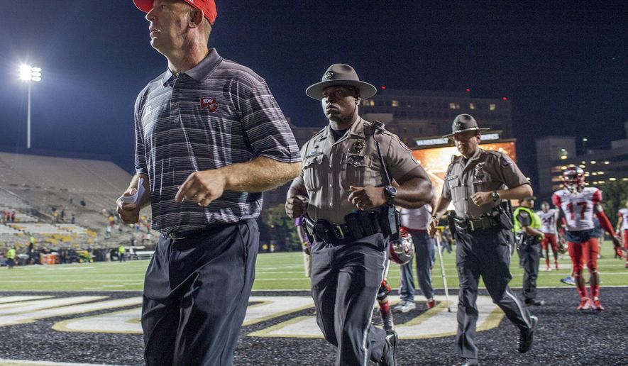 Western Kentucky coach Jeff Brohm leaves the field after an NCAA college football game against Vanderbilt, Thursday, Sept. 3, 2015, in Nashville, Tenn. Western Kentucky won 14-12. (Austin Anthony/Daily News via AP) MANDATORY CREDIT