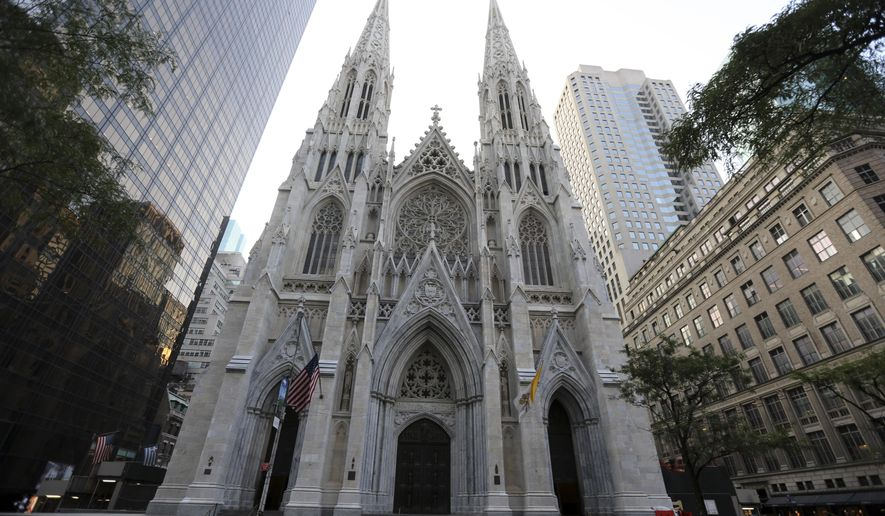 FILE - This Sunday, Aug. 30, 2015 file photo shows the newly renovated and cleaned facade of St. Patrick's Cathedral in New York. The Cathedral underwent a renovation, done in three phases over three years, starting in 2012 and is slated to be finished before the Pope's visit in September 2015. (AP Photo/Mary Altaffer)