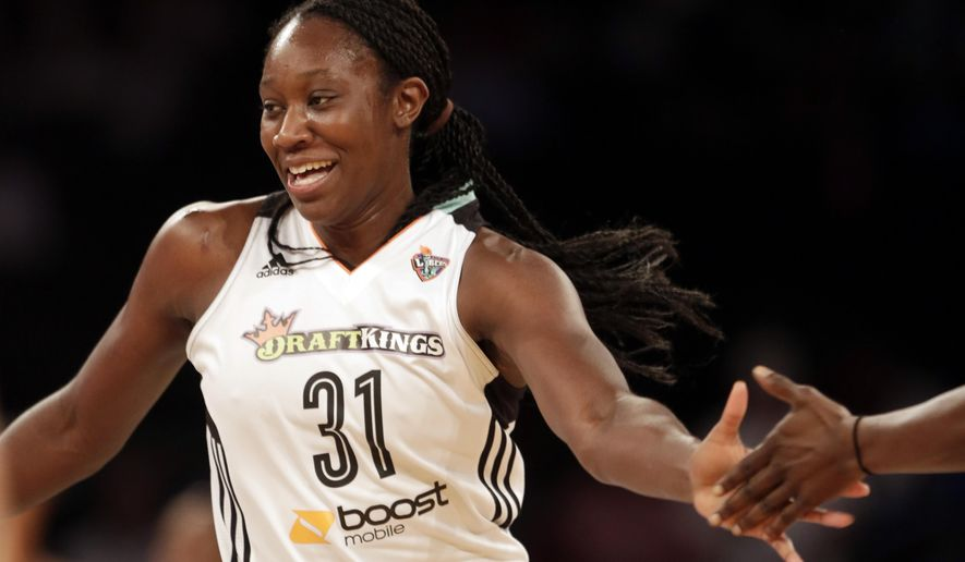 New York Liberty's Tina Charles slaps hands with a teammate after a steal and a basket against the Connecticut Sun in a basketball game, Wednesday, Sept. 9, 2015, at Madison Square Garden in New York. (AP Photo/Mark Lennihan)