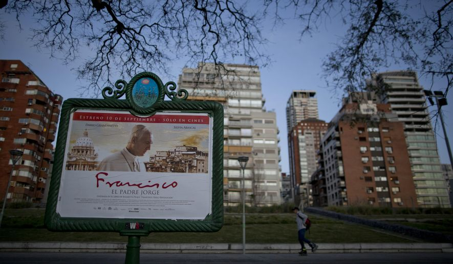 "A man walks by a poster advertising ""Francisco. El Padre Jorge"", the film by director Beda Docampo Feijoo about Pope Francis 's life, in Buenos Aires, Argentina, Tuesday, Sept. 8, 2015.  The film will hit the cinemas on Sept. 10. (AP Photo/Natacha Pisarenko)"