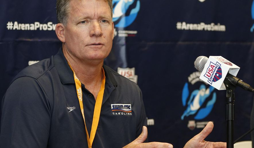 FILE - In this May 14, 2015, file photo, David Marsh answers a question during a press conference at the Arena Pro Swim Series meet in Charlotte, N.C. USA Swimming has picked Bob Bowman and David Marsh as its head coaches for the 2016 Olympics. The organization made the announcement Wednesday, Sept. 9, 2015, during a coaching convention in Cleveland. (AP Photo/Nell Redmond, File)