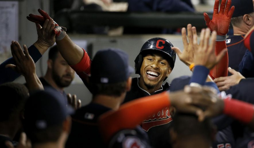 Cleveland Indians' Francisco Lindor celebrates his home run off Chicago White Sox starting pitcher Jeff Samardzija, during the fifth inning of a baseball game Wednesday, Sept. 9, 2015, in Chicago. (AP Photo/Charles Rex Arbogast)