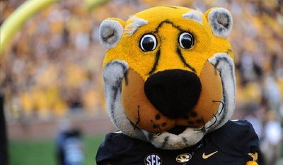 Named after President Harry Truman, this tiger has been rooting for which team since the mid 1980s?
