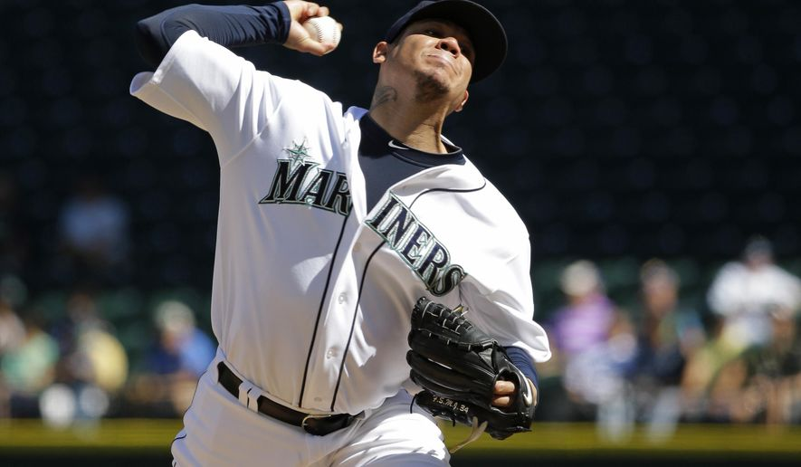 Seattle Mariners starting pitcher Felix Hernandez throws against the Texas Rangers in the fourth inning of a baseball game, Thursday, Sept. 10, 2015, in Seattle. (AP Photo/Ted S. Warren)