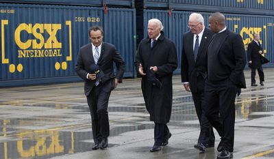 This Nov. 6, 2013, file photo shows Chief Operating Officer and Executive Vice President of CSX Corporation Oscar Munoz, left, Vice President Joe Biden, second from left, Wilby Whitt, CSX Intermodal Terminals Inc. president, second from right, and Secretary of Transportation Anthony Foxx, touring the CSX facility, N. Baltimore, Ohio. (Amy E. Voigt/The Blade via AP)