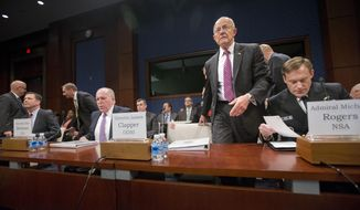 Director of National Intelligence James Clapper, center, takes his seat on Capitol Hill in Washington, Thursday, Sept. 10, 2015, prior to testifying House Intelligence Committee hearing on cyber threats. From left are, FBI Director James Comey, CIA Director John Brennan, and Clapper, and Director of the National Security Agency Adm. Michael Rodgers.  (AP Photo/Pablo Martinez Monsivais)