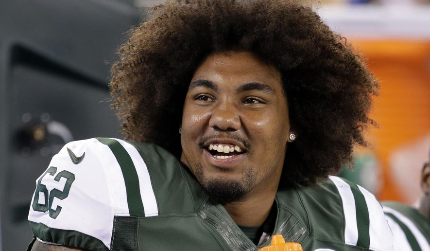FILE - In this Sept. 3, 2015, file photo, New York Jets defensive tackle Leonard Williams talks with  teammates during the second half of a preseason NFL football game against the Philadelphia Eagles in East Rutherford, N.J. Williams is a large man with huge hair and enormous expectations. Williams is all set for his NFL regular-season debut, the capper to a life-changing last few months for the rookie. (AP Photo/Peter Morgan, File)