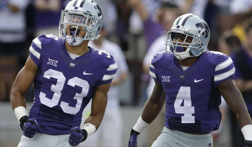 Kansas State kick return specialist Morgan Burns (33) celebrates his 103-yard kick return for a touchdown with wide receiver Dominique Heath (4) during the first half of an NCAA college football game against South Dakota in Manhattan, Kan., Saturday, Sept. 5, 2015. (AP Photo/Orlin Wagner)