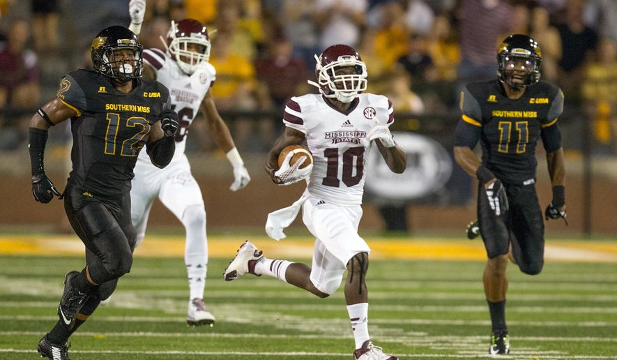 Mississippi State running back Brandon Holloway (10) breaks through a hole in the Southern Mississippi kick coverage to score a touchdown to give MSU a 7-3 lead in the first quarter of an NCAA college football game on Saturday, Sept. 5, 2015 in Hattiesburg, Miss. (Keith Warren/The Clarion-Ledger, via AP)