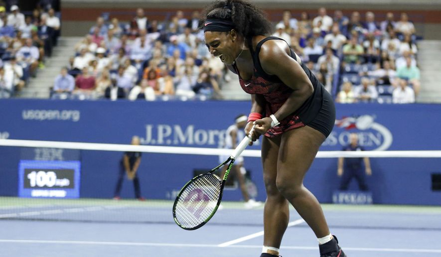 Serena Williams reacts after winning a point against Venus Williams during a quarterfinal match at the U.S. Open tennis tournament, Tuesday, Sept. 8, 2015, in New York. (AP Photo/Julio Cortez)