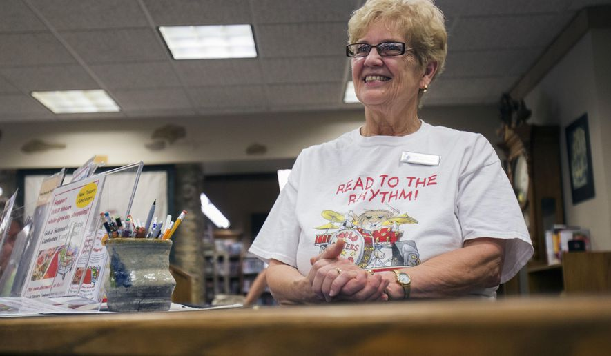 In this July 30, 2015 photo, library director Bonnie Estrada listens during a summer reading program at the Talcott Free Library in Rockton, Ill. Estrada retired from the library at the end of August after 41 years of service. (Max Gersh/Rockford Register Star via AP)