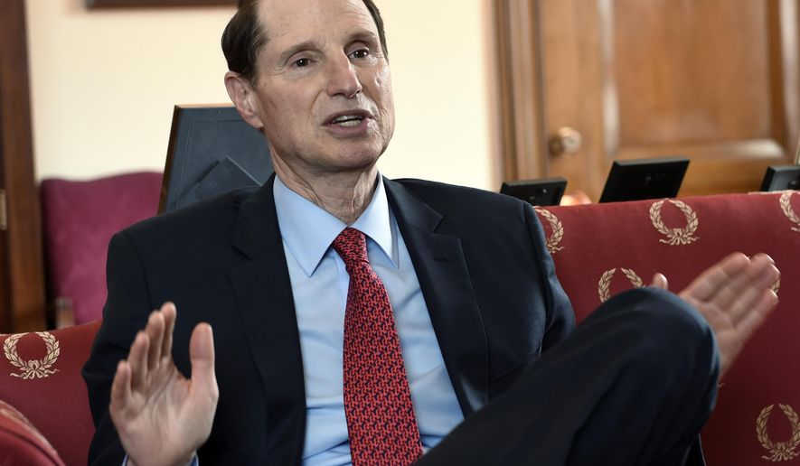 """FILE - In this May 13, 2015 file photo, Sen. Ron Wyden, D-Ore, speaks during an interview in his office on Capitol Hill in Washington. Some strident opponents of the nuclear accord with Iran are invoking memories of the Holocaust in an effort to defeat the agreement. Those arguments, however, failed to sway Wyden who grew up hearing stories of the Holocaust firsthand. """"My parents told me at a young age what it was like to live in fear,"""" said Wyden. """"For German Jews, the fear was always the knock on the door in the night."""" Wyden said his parents escaped Germany in the 1930s, but not before both of his grandfathers lost their livelihoods and his father was kicked out of school for being Jewish.  (AP Photo/Susan Walsh, File)"""